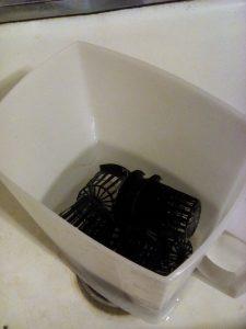 I soak the net pots in hot water and a little bit of vinegar.