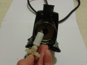 Inside the Tower Garden pump, you'll see something like this with a magnet on the end. Pull it out.